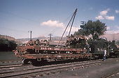 A Durango yard scene showing wrecked D&amp;RGW flat car #1293 loaded on flat car #6308.  The crew is finishing up by loading the trucks and draft gear.<br /> D&amp;RGW  Durango, CO