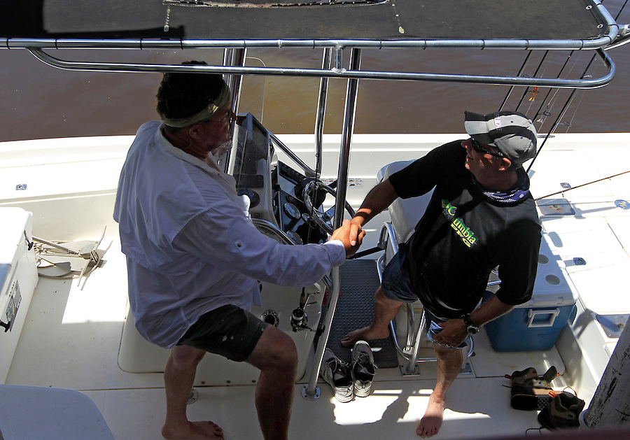 Capt. Tom Shurtleff, right, shakes hands with Steve Scalish after his first trip in Florida's Everglades National Park out of Chokoloskee Island and the 10,000 Islands National Wildlife Refuge. Photo/Andrew Shurtleff
