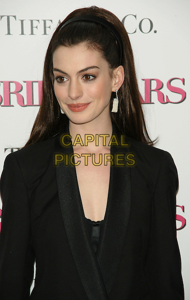 "ANNE HATHAWAY.New York Premiere of ""Bride Wars"".at the AMC Loews Lincoln Square Cinemas, New York, NY, USA..January 5th, 2009.half length black jacket suit dangling earrings hair band hairband dangling white earrings .CAP/LNC/TOM.©TOM/LNC/Capital Pictures."