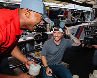Jul 20, 2018; Morrison, CO, USA; NHRA top fuel driver Antron Brown with USA snowboarding olympian Louie Vito during qualifying for the Mile High Nationals at Bandimere Speedway. Mandatory Credit: Mark J. Rebilas-USA TODAY Sports