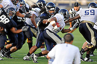 12 August 2011:  FIU's James Jones (94) grabs Jeremiah Harden (6) behind the line during a scrimmage held as part of the FIU 2011 Panther Preview at University Park Stadium in Miami, Florida.