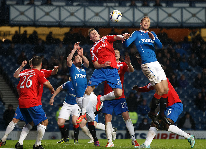 Craig Johnstone of Cowdenbeath challenges with Bilel Mohsni
