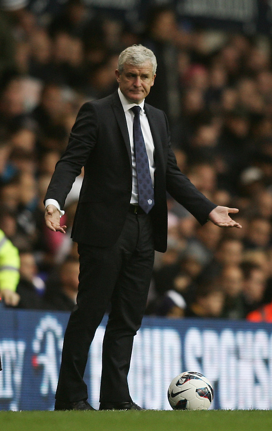Dejected Queens Park Rangers' Manager Mark Hughes ..Football - Barclays Premiership - Tottenham Hotspur v Queens Park Rangers - Sunday 23rd September 2012 - White Hart Lane - London..
