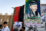 Supporters of Gul Agha Sherzai decorate the outside of  his compound with Afghan flags and posters of Hamid Karzai in Kandahar, Afghanistan, Aug. 19, 2009. Sherzai, the current governor of Nangarhar province, was thought to consider running against Karzai in Thursday's presidential election, but he threw his support behind the incumbent. Karzai is from Kandahar province and is expected to have strong support at the polls there.