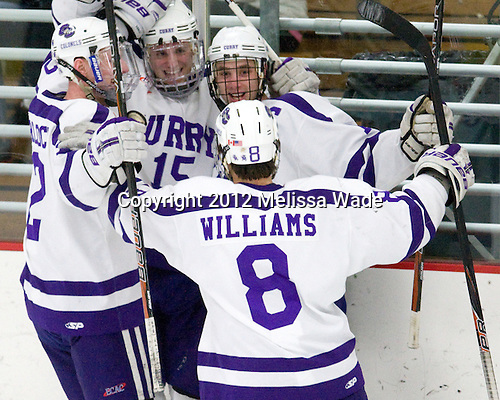 Ryan Barlock (Curry - 2), Steven Mohler (Curry - 15), John Williams (Curry - 8), Payden Benning (Curry - 13) - The Curry College Colonels defeated the Johnson & Wales University Wildcats 5-4 on Curry's senior night on Saturday, February 18, 2012, at Max Ulin Rink in Milton, Massachusetts.