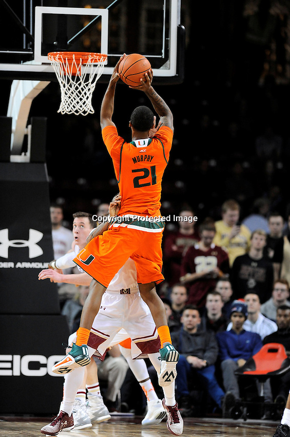 Wednesday January 20, 2016: Miami (Fl) Hurricanes forward Kamari Murphy (21) takes a shot during the second half of the NCAA men's basketball game between the Miami Hurricanes and the Boston College Eagles at Conte Forum, in Chestnut Hill, Mass.  Miami beats Boston 67-53. Eric Canha/CSM