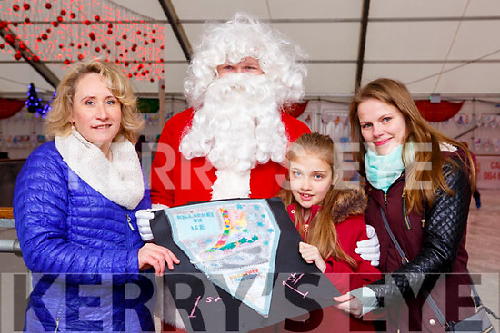 Bernadette O'Donoghue Killarney On Ice and Santa Claus presents Oliwia Smyczek Killarney  with her mum Edyta Bielesz the Killarney on Ice colouring competition 1st prize on Saturday