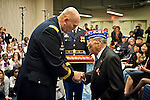 U.S. Army Chief of Staff Gen. Raymond T. Odierno presents a Bronze Star Medal  and the Army Chief of Staff coin to George Joe Sakato at the WWII Nisei Veterans Program National Veterans Network tribute to the 100th Infantry Battalion, 442nd Regimental Combat Team and Military Intelligence Service Nov. 1, 2011 in Washington, D.C. Sakato is a Medal of Honor recipient and a Japanese- American World War II veteran. (U.S. Army photo by Staff Sgt. Teddy Wade/AFLO) [0006]