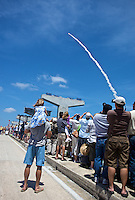 Spectators on a Titusville, FL bridge watch Space Shuttle Atlantis and it's crew of 6 (Commander Ken Ham, Pilot Tony Antonelli, Mission Sppecialists Garrett Reisman, Michael Good, Piers Sellers, and Steve Bowen) blast off to begin the STS-132 mission on Friday, May 14, 2010.  (Photo by Brian Cleary/www.bcpix.com)