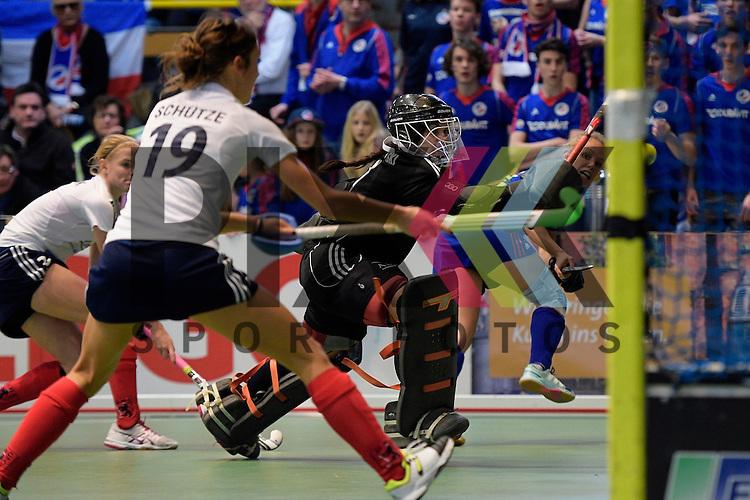 GER - Luebeck, Germany, February 07: During the 1. Bundesliga Damen indoor hockey final match at the Final 4 between Mannheimer HC (blue) and Duesseldorfer HC (white) on February 7, 2016 at Hansehalle Luebeck in Luebeck, Germany.   Lydia Haase #12 of Mannheimer HC tries to score; Nathalie Kubalski (TW) #1 of Duesseldorfer HC, Lisa-Marie Schuetze #19 of Duesseldorfer HC<br /> <br /> Foto &copy; PIX-Sportfotos *** Foto ist honorarpflichtig! *** Auf Anfrage in hoeherer Qualitaet/Aufloesung. Belegexemplar erbeten. Veroeffentlichung ausschliesslich fuer journalistisch-publizistische Zwecke. For editorial use only.