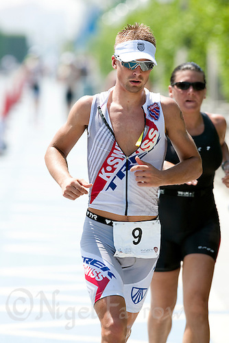13 MAR 2010 - ABU DHABI, UAE - Fraser Cartmell who was the first British male finisher at the Abu Dhabi International Triathlon in 4th place in a time of 6h36m12 (PHOTO (C) NIGEL FARROW)