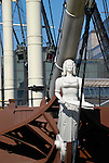 Close up of masthead and bow of Three Sisters pirate ship replica at Tobacco Dock, Wapping, London
