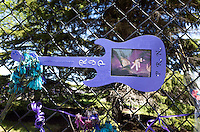 Prince's portrait on purple cut out wooden guitar on chain-linked fence. Paisley Park Studios Chanhassen Minnesota MN USA