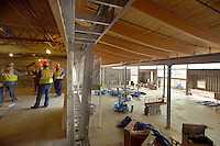STAFF PHOTO BEN GOFF  @NWABenGoff -- 12/12/14 Members of the Bentonville City Council tour the Learning Lofts area overlooking the main gallery space inside the Amazeum in Bentonville with members of the Amazeum staff and Nabholz Construction Services on Friday Dec. 12, 2014.