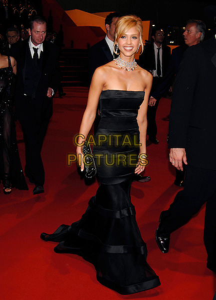 "JESSICA ALBA.Departs ""Sin City"" Screening,.during the 58th International Cannes Film Festival, Cannes, France, May 18th 2005..full length black strapless dress diamond necklace choker earrings jewellery clutch bag.Ref: PL.www.capitalpictures.com.sales@capitalpictures.com.©Phil Loftus/Capital Pictures"