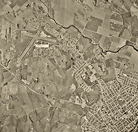 historical aerial photograph of Watsonville and the Watsonville Municipal Airport (WVI), Watsonville, Santa Cruz County,  California, 1956.  For historical aerial photographs of  not shown Watsonville on this web site, please contact Aerial Archives directly.