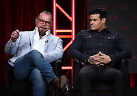 """BEVERLY HILLS - AUGUST 6: (L-R) Co-Creators/Executive Producers/Writers Kurt Sutter and Elgin James onstage during the """"Mayans M.C."""" panel at the FX Networks portion of the Summer 2019 TCA Press Tour at the Beverly Hilton on August 6, 2019 in Los Angeles, California. (Photo by Frank Micelotta/FX Networks/PictureGroup)"""