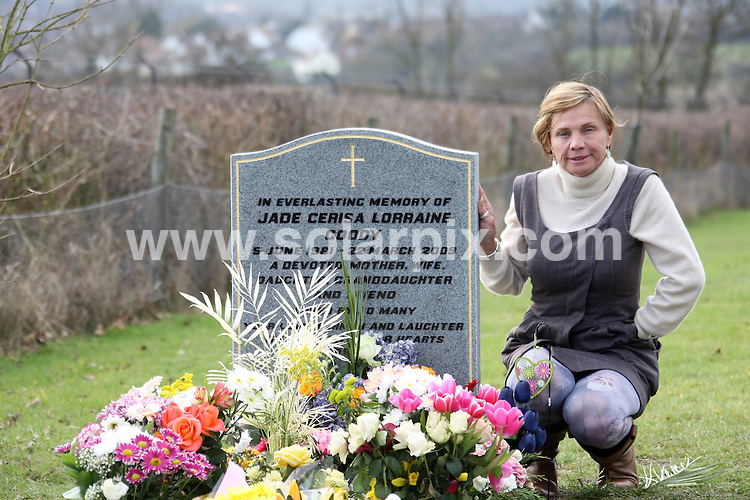 **ALL ROUND PICTURES FROM SOLARPIX.COM**.**WORLDWIDE SYNDICATION RIGHTS**.memorial service for the reality star Jade Goody, held the day before the first anniversary of her death from cervical cancer, in her home town of Bermondsey in London, UK. 21 March 2010..This pic: Jackiey Budden tends Jade's grave..JOB REF: 10951 SKD       DATE: 21_03_2010.**MUST CREDIT SOLARPIX.COM OR DOUBLE FEE WILL BE CHARGED**.**MUST NOTIFY SOLARPIX OF ONLINE USAGE**.**CALL US ON: +34 952 811 768 or LOW RATE FROM UK 0844 617 7637**