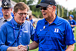 Duke President Vincent Price congratulates Duke head football coach David Cutcliffe as Duke beats Northwestern Wildcats 41-17. The win improved Duke's record to 2-0
