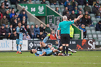 Carl McHugh of Plymouth Argyle challenges Matthew Bloomfield of Wycombe Wanderers, sparking a brawl during the Sky Bet League 2 match between Plymouth Argyle and Wycombe Wanderers at Home Park, Plymouth, England on 30 January 2016. Photo by Mark  Hawkins / PRiME Media Images.