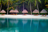 Beach on lagoon with umbrellas and chairs. Bora Bora. French Polynesia