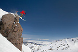 USA, California, Mammoth, a brightly colored skier carves his way down the run at Mammoth Ski Resort