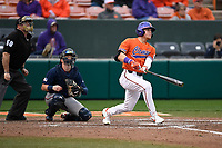 Right fielder Michael Green (11) of the Clemson Tigers bats in a game against the South Alabama Jaguars on Opening Day, Friday, February 15, 2019, at Doug Kingsmore Stadium in Clemson, South Carolina. The catcher is Carter Perkins and the umpire is Craig Barron. Clemson won, 6-2. (Tom Priddy/Four Seam Images)