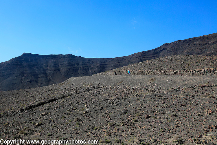 Cycling in barren landscape of Jandia peninsula Fuerteventura, Canary Islands, Spain