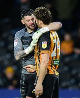 Sheffield Wednesday's Keiren Westwood, left, with Hull City's Chris Martin after he had conceded a penalty by fouling the Hull City striker<br /> <br /> Photographer Chris Vaughan/CameraSport<br /> <br /> The EFL Sky Bet Championship - Hull City v Sheffield Wednesday - Saturday 12th January 2019 - KCOM Stadium - Hull<br /> <br /> World Copyright © 2019 CameraSport. All rights reserved. 43 Linden Ave. Countesthorpe. Leicester. England. LE8 5PG - Tel: +44 (0) 116 277 4147 - admin@camerasport.com - www.camerasport.com