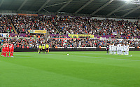 Pictured: York and Swansea players observe a minute's silence before kick off Tuesday 25 August 2015<br />