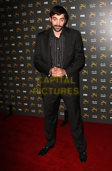 "RHYS COIRO.""24"" 150th Episode & Season 7 Premiere Party held at XIV, Hollywood, California, USA..January 6th, 2009.full length black suit.CAP/ADM/KB.©Kevan Brooks/AdMedia/Capital Pictures."