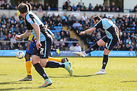 Paul Hayes of Wycombe Wanderers (right) shoots during the Sky Bet League 2 match between Wycombe Wanderers and Mansfield Town at Adams Park, High Wycombe, England on 25 March 2016. Photo by David Horn.