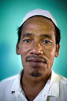 The Malee family has just been attacked by unknown gunmen inside the house killing their daughter. Thailand is struggling to keep up appearances as the land of smiles has to face up to its troubled south. Since 2004 more than 3500 people have been killed and 4000 wounded in a war we never hear about. In the early hours of January 4th 2004 more than 50 armed men stormed a army weapons depot in Narathiwat taking assault rifles, machine guns, rocket launchers, pistols, rocket-propelled grenades and other ammunition. Arsonists simultaneously attacked 20 schools and three police posts elsewhere in Narathiwat. The raid marked the start of the deadliest period of armed conflict in the century-long insurgency. Despite some 30,000 Thai troops being deployed in the region, the shootings, grenade attacks and car bombings happen almost daily, with 90 per cent of those killed being civilians. 24.09.07. Photo: Christopher Olssøn