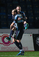 Paul Hayes of Wycombe Wanderers congrats goal scorer Michael Harriman of Wycombe Wanderers during the Sky Bet League 2 match between Wycombe Wanderers and Notts County at Adams Park, High Wycombe, England on 15 December 2015. Photo by Andy Rowland.