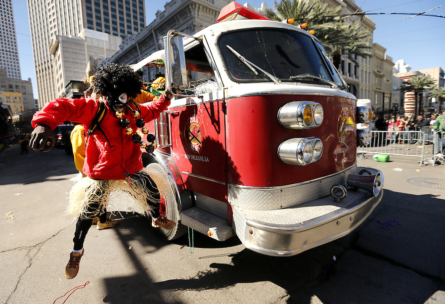 NEW ORLEANS, LOUISIANA - FEBRUARY 9, 2016:  A member of the Zulu Social Aid and Pleasure Club parades down Canal Street during Mardi Gras day on February 9, 2016 in New Orleans, Louisiana. Fat Tuesday, or Mardi Gras in French, is a celebration traditionally held before the observance of Ash Wednesday and the beginning of the Christian Lenten season. (Photo by Jonathan Bachman/Getty Images)