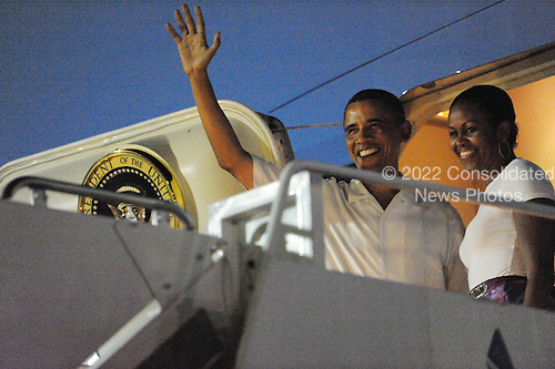 United States President Barack Obama and First Lady Michelle Obama wave before boarding Air Force One, as they depart from Joint Base Pearl Harbor-Hickam, in Honolulu, Hawaii on Monday, January 3, 2010..Credit: Cory Lum / Pool via CNP
