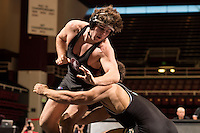 STANFORD, CA - January 18, 2015: Ryan Davies of the Stanford Cardinal wrestling team competes during a meet against Cal Poly at Maples Pavilion. Stanford won 22-13.