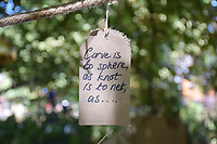 Latitude Festival, Henham Park, Suffolk, UK July 2018. Note hanging in a tree in the woods