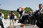 Maj. Gen. James Hughes, as ranking officer for the Commonwealth delegation, leads a wreath-laying commemorative event for the 60th anniversary of the start of the Korean War at the National Cemetery in Seoul, South Korea..Photographer: Rob Gilhooly .
