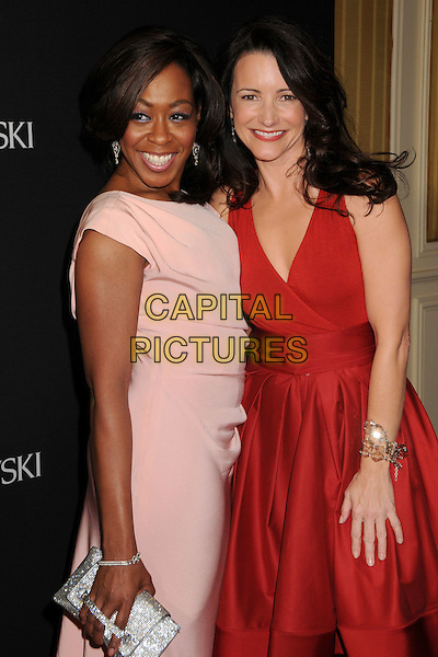 TICHINA ARNOLD & KRISTIN DAVIS.11th Annual Costume Designers Guild Awards at the Four Seasons Beverly Wilshire Hotel, Beverly Hills, California, USA..February 17th, 2009.half length red dress pink silver clutch bag.CAP/ADM/BP.©Byron Purvis/AdMedia/Capital Pictures.