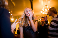 United Kingdom / London / United Kingdom / 07.12.2006..Zane Mellupe, 25, a Latvian photographer, smokes at a bar on London's South Bank...© Davin Ellicson / Anzenberger..