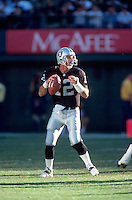 OAKLAND, CA - Quarterback Rich Gannon of the Oakland Raiders in action during a game against the Miami Dolphins at the Oakland Coliseum in Oakland, California in 1999. Photo by Brad Mangin