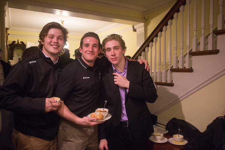 Liam Geither, left, Reilly Moore, center, and Jake Houston, right pose for a picture during the 1960s hockey alumni event at the Konneker Alumni House on Sept. 30, 2016.