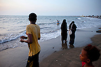 Families meet at dusk on the beach of the Red Sea in Hodeidah City.