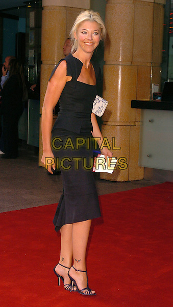 """TAMARA BECKWITH.""""The Break Up"""" UK film premiere.vue cinema, Leicester Square, London England.14th June 2006.Ref: CAN.full length clutch bag handbag.www.capitalpictures.com.sales@capitalpictures.com.©Can Nguyen/Capital Pictures"""