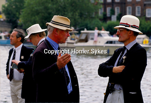 MEN, TALKING, WEARING STRAW HATS & BLUE BLAZERS, AT THE HENLEY ROYAL REGATTA, HENLEY ON THAMES, OXON,