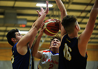 Action from the 2017 AA Boys' Secondary Schools Basketball Premiership National Championship match between St Kevin's College (white and red) and Otaki College (navy) at the B&M Centre in Palmerston North, New Zealand on Tuesday, 3 October 2017. Photo: Dave Lintott / lintottphoto.co.nz