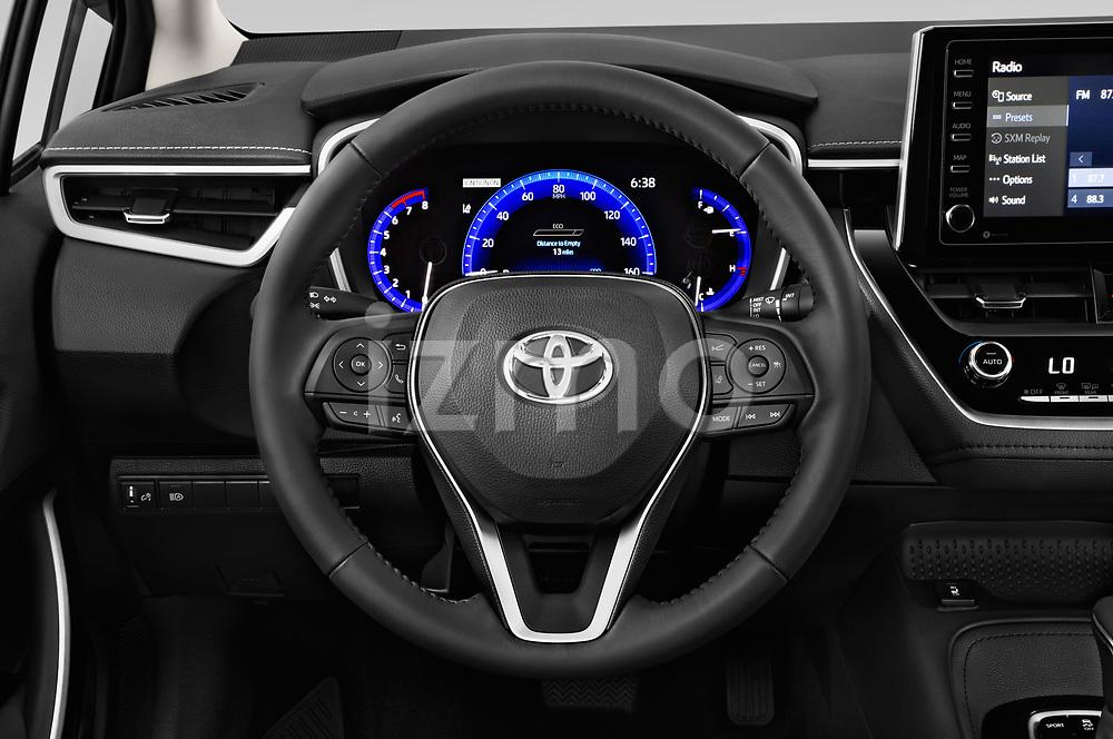 Car pictures of steering wheel view of a 2020 Toyota Corolla XLE 4 Door Sedan