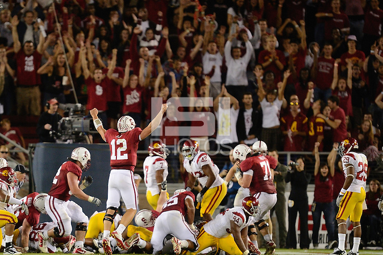 STANFORD, CA - SEPTEMBER 4: Stanford football quarterback Andrew Luck celebrates a touchdown against the USC Trojans on October 9, 2010 at Stanford Stadium / Foster Field in Stanford, CA.  Stanford won 37-35.