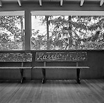Old Benches with advertising painted on them on a dance floor of the Mountain Lake Inn in Pennsylvania